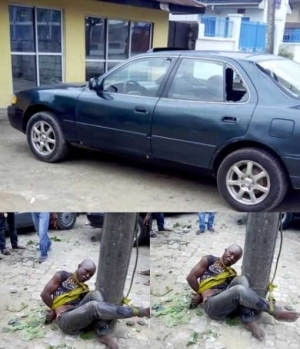 OMG!!! Notorious Thief Beaten to Pulp & Tied to Pole After a Failed Operation (See Photo)